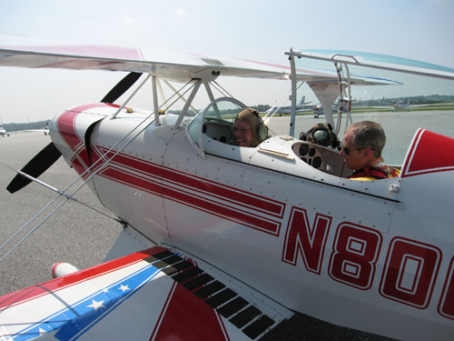 Bud runs through some last minute checks before taking Paul up in his plane. Photo Fiona Adler