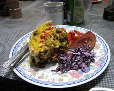This is the meal we were served right after sending last night's update. Quiche, coleslaw and sausage, followed by fruit cake for dessert. Fantastic! Photo Paul Adler.