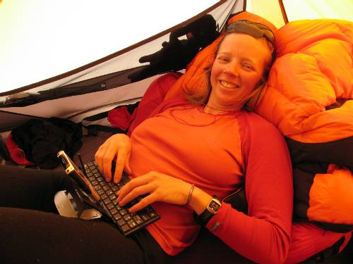 Fiona writes today's update in our tent, propped up against her down jacket & suit. Photo Paul Adler.