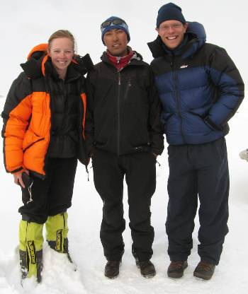 Fiona, Mingma and Paul standing in the thick snow at base camp. Photo Jack Gerstein.