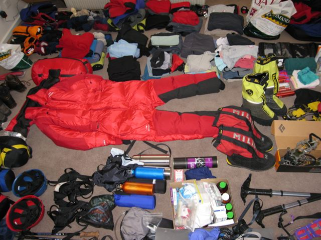 All our Everest climbing and trekking gear is laid out in our lounge room for final checking before packing it into kit bags. Photo Fiona Adler