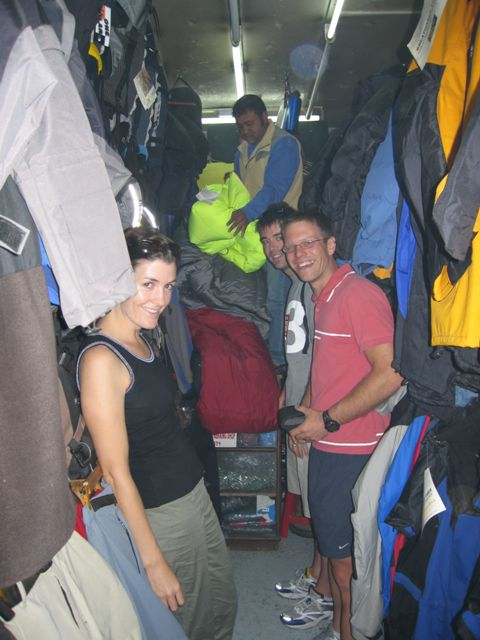 Bridget, Chris and Paul shopping for a down jacket inside a very small gear shop in Kathmandu. Yes, you are looking at the entire shop in this photo! Photo Fiona Adler