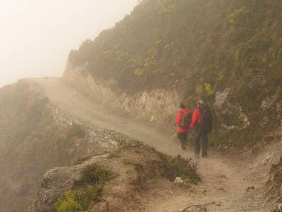 Paul and Mary heading down to Namche in the fog. Photo Fiona Adler