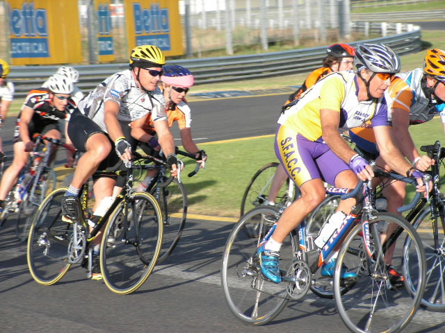 Fiona (pink fabric on her helmet) tucked into the bunch at Sandown racecourse on Tuesday. Picture courtesy of Caulfield Carnegie Cycling Club.