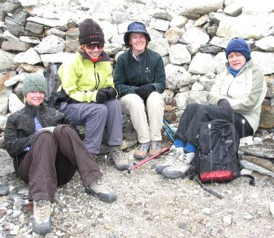 Beck, Fiona, Liz and Marg sheltering from the snow at Pumori Base Camp. Photo: Paul Adler