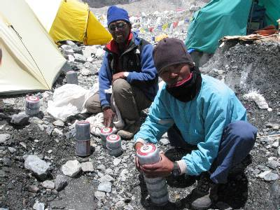 Lakpa Dorje and Lakpa Sherpa getting cooking gas ready to take up to the high camps. Photo Paul Adler.