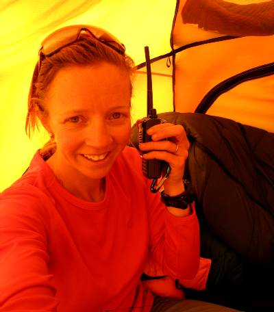 On the radio to Paul from my tent at base camp. Photo Fiona Adler