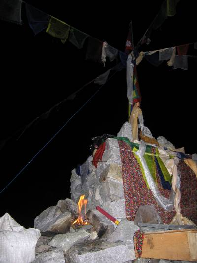 Burning incense and Juniper at the Puja Altar at basecamp. It is said to bring good luck and safe passage for climbers on the mountain. Photo Fiona Adler