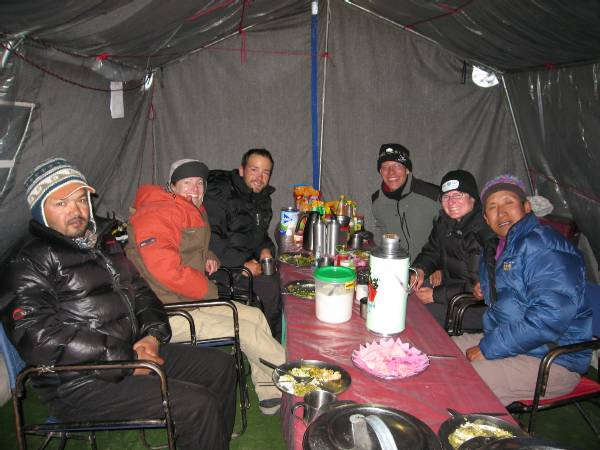 Enjoying dinner of satay chicken and vegetables last night. From left to right, Liaison Officer, Rene, Atilla, Paul, Meagan, Ptemba. Everyone else is up higher. Photo Paul Adler.