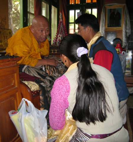 Lakpa Nuru and his wife & child receiving a blessing from the Lama. Photo Tim Adler.