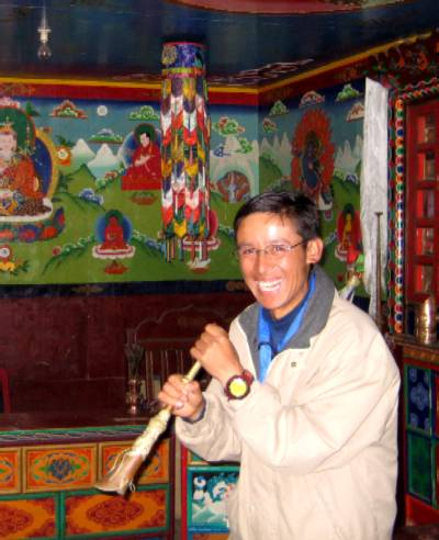 Our guide, Ang Lima, demonstrates a traditional Sherpa horn. Photo Liz James.
